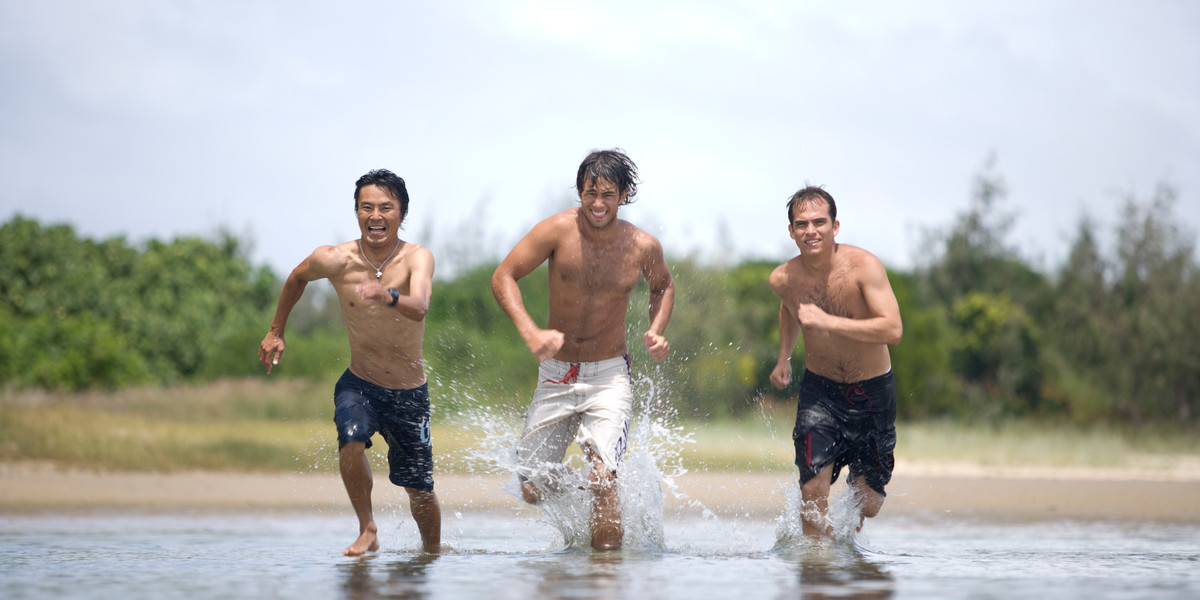 Students_ Satoshi Yamashita_ from Japan _left_ Hernando Garcia_ from Colombia _centre_ Alberto Rodriguez_ from Colombia _right_ running through water